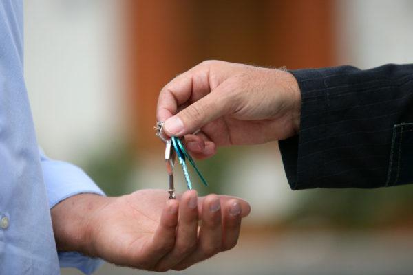 salesman handing over keys
