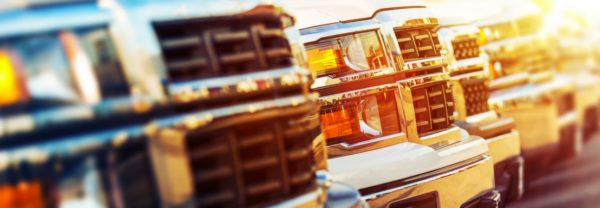 A close up of a line of truck's grilles featured in a blog about used trucks