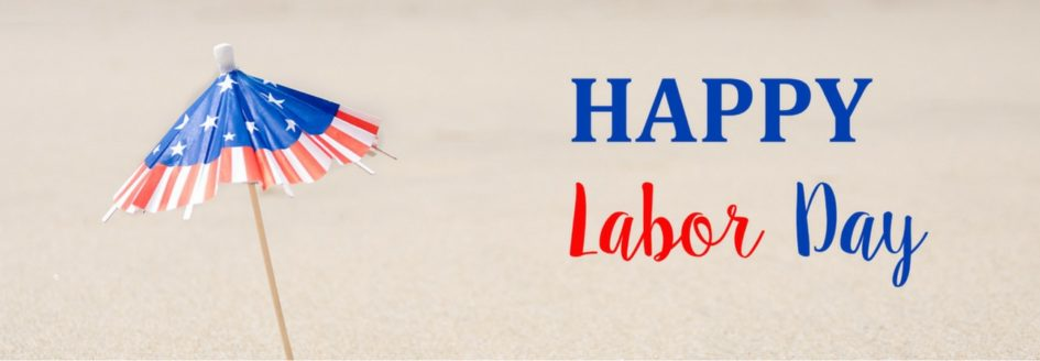 """Close up of an American Flag toothpick umbrella with the text """"Happy Labor Day"""""""