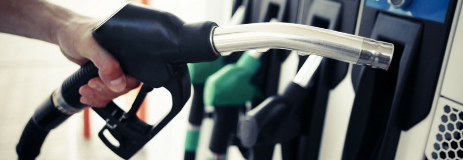 A close up of a gas pump featured in a blog about fuel-saving driving tips