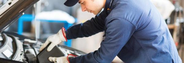 Technician servicing car